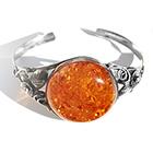 round orange amber bangle