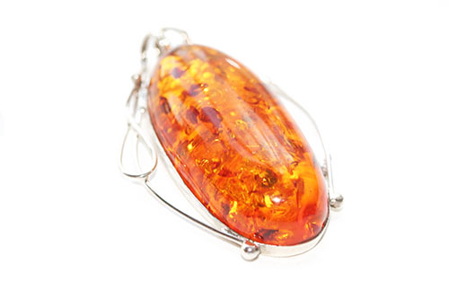 orange amber in ornate pendant