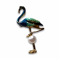 a brooch of a bird that looks like a blue flamingo