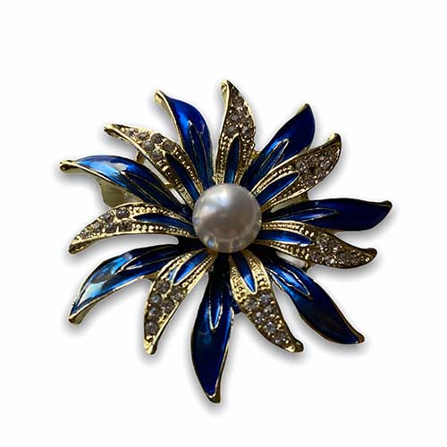 a colourful flower brooch with a pearl as its centrepiece