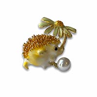 a hedgehog brooch with a pearl