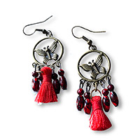 dangle earrings with a red tassle