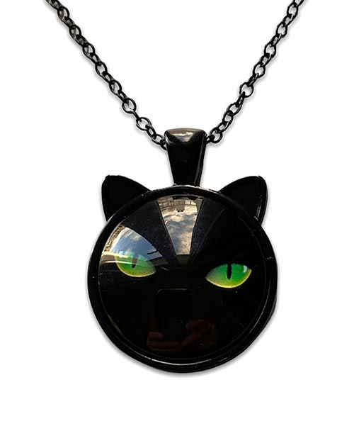 necklace with a pendant of a black cat with green eyes