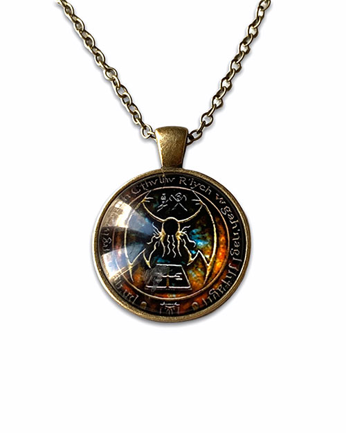 necklace with a glass pendant of cthulha