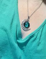 eye necklace being worn around the neck
