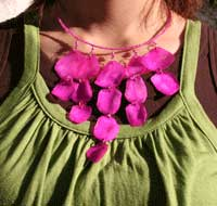 model wearing pink shell necklace