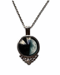 steel necklace with glass pendant of the moon