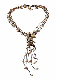 pearl necklace with red garents and a few cat eye stones