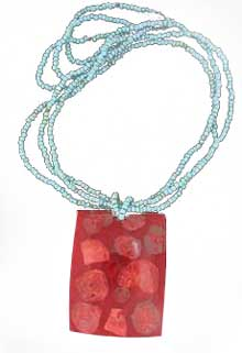 turquoise beaded necklace with red coral pendant