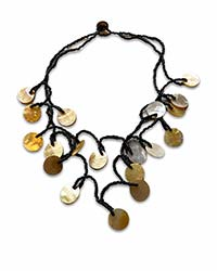 a choker of shells in disc shapes