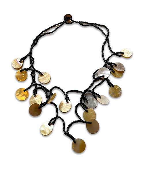 a choker of disc shaped shells with small black beads