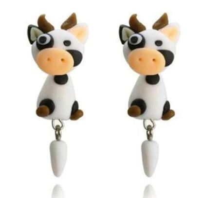 stud earrings of a pair of cows