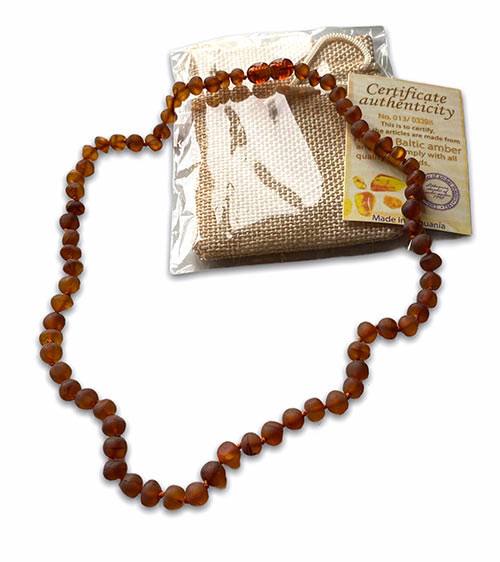 a necklace with small cognac baltic amber beads