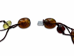 a necklace clasp made from multi-colours of amber