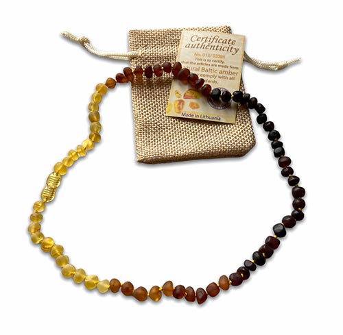 a necklace with three colours of baltic amber beads
