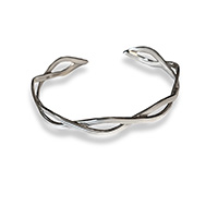 a sterling silver bangle with a celtic knot pattern