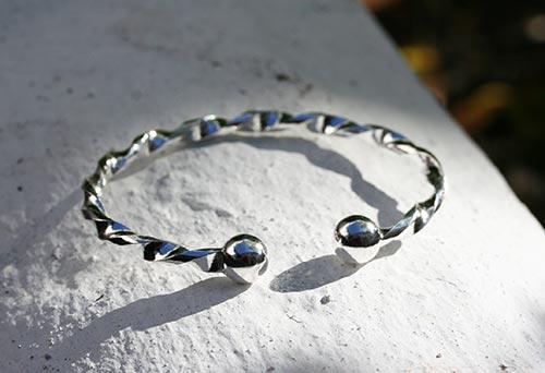 braiding wrapped around a silver bangle