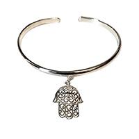 a sterling silver bangle with a silver hamsa