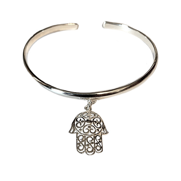 a sterling silver bangle in a plain cuff design with a hanging siver hamsa pendant