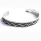silver bangle with zig-zag pattern