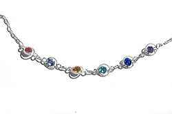 silver anklet with gemstone crystals