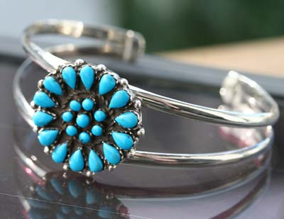 silver cuff bangle with turquoise stones