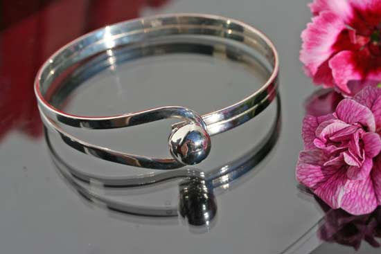 silver bangle with a sphere