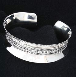silver cuff bangle with braided interior