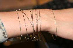 multiple bangles on wrist