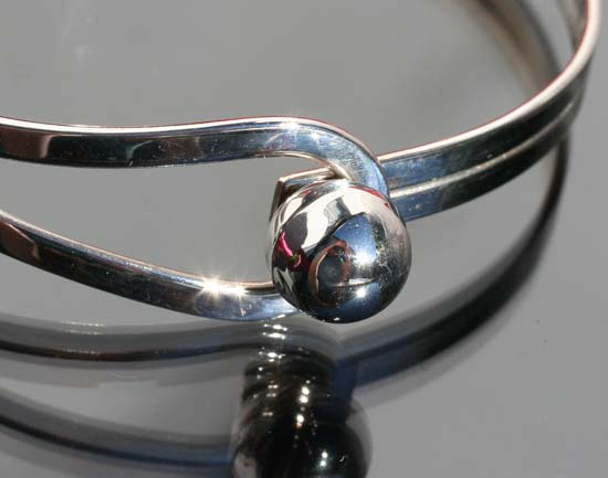 spherical silver bangle