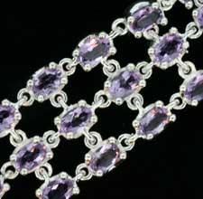 amethyst crystals clawed onto a silver bracelet