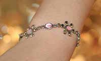 silver bracelet with mother of pearl flowers on a wrist