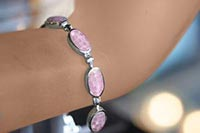 silver bracelet with mosiac of pink mother of pearl on a wrist