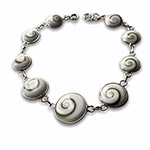nine circular shapes of natural shiva-shell on silver bracelet