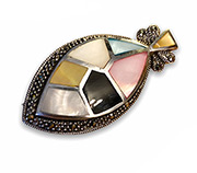 combines silver brooch and pendant