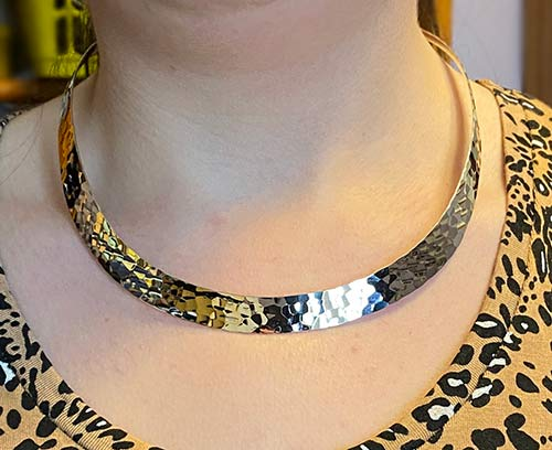 silver choker with hammered effect.
