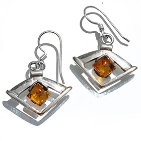 eye shaped silver earrings with amber