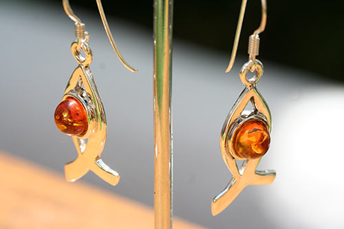silver fish earrings with amber