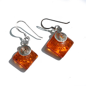 diamond shaped silver earrings with amber