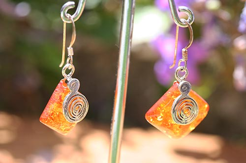silver earrings with amber and a swirl