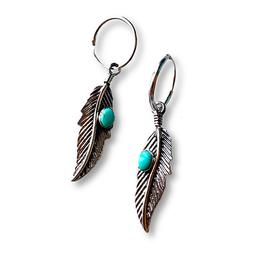 silver hoop earring with a turquoise set in a silver leaf