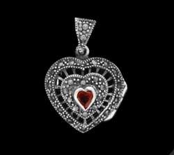 garnet on silver locket