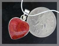 red coral necklace next to 10p coin