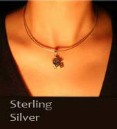 lady wearing a silver chinese astrology pendant