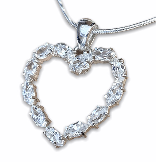 Oval cut zirconia clawed in a heart shaped sterling silver pendant