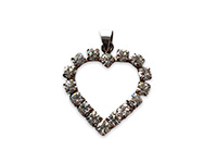a silver pendant in the shape of a heart with white crystals