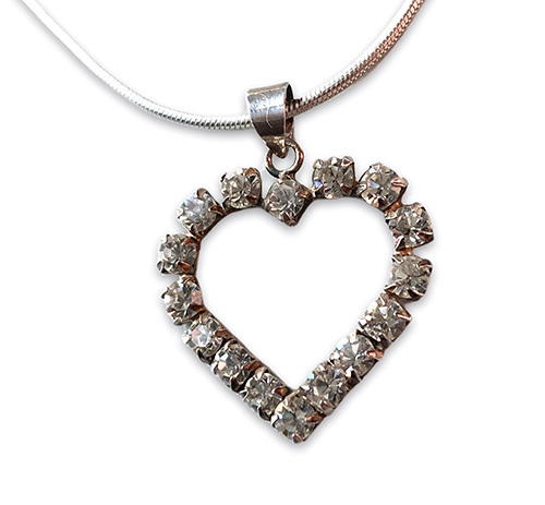 a silver heart pendant with white crystals