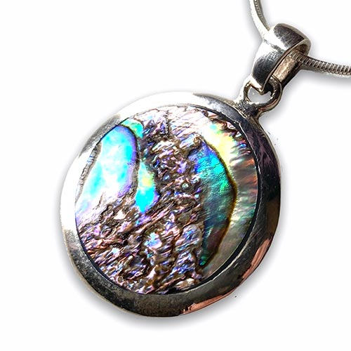 silver pendant with a round paua shell