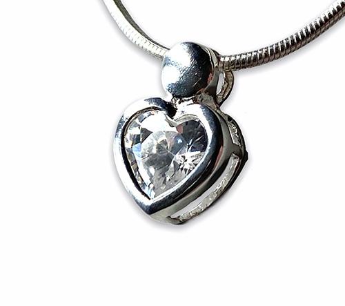 a small silver heart pendant