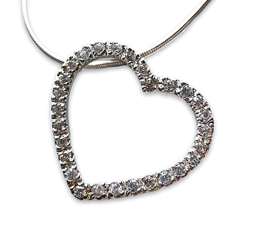 a silver heart pendant with white zirconia